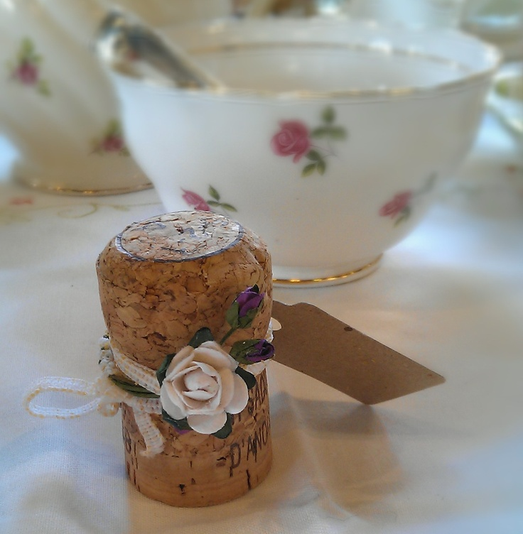 Champagne cork for wedding table place setting - write the guests name on the label. From www.lavenderandlinen.co.uk