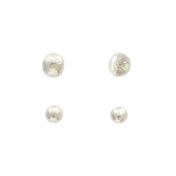 These molten drops of sterling silver are a classic, everyday stud to adorn your ears. Each stud will have a their own unique look due to the handmade process of creating this earring.