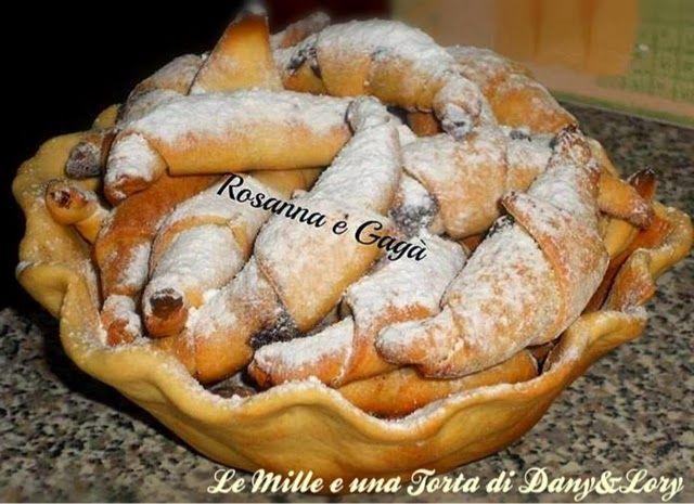 CESTINO DI CORNETTI ALLA NUTELLARICETTA DI: ROSANNA E GAGÀ   Ingredienti:    850 gr di farina-3 uova intere-200gr di burro (margarina),40 gr di lievito di birra (sciolto in un bicchiere di latte tiepido),-grattugiata di 1 limone-1 bustina di vanillina-1 pizzico di sale,2 cucchiai di zucchero.
