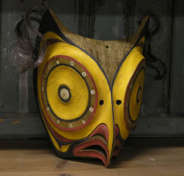 Northwest Coast Native American carved cedar owl mask, polychrome decorated and inlaid with abalone buttons, human hair, first quarter to mid 20th century