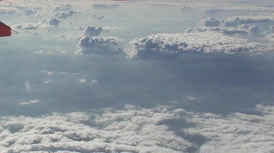 stock-footage-view-from-passenger-jet-of-sunny-cloudy-skies.jpg (400×224)