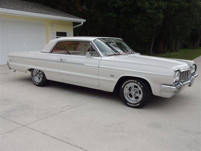 Pin Challenge: FIRST CAR. Mine was a 64 Chevy Impala. White with red interior and 3 on the column.  What was your first car?