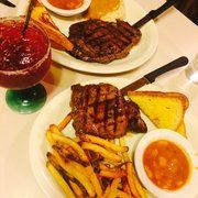 Photo of Old Town Cafe - West Yellowstone, MT, United States. Buffalo ribeye and top sirloin and huckleberry margarita