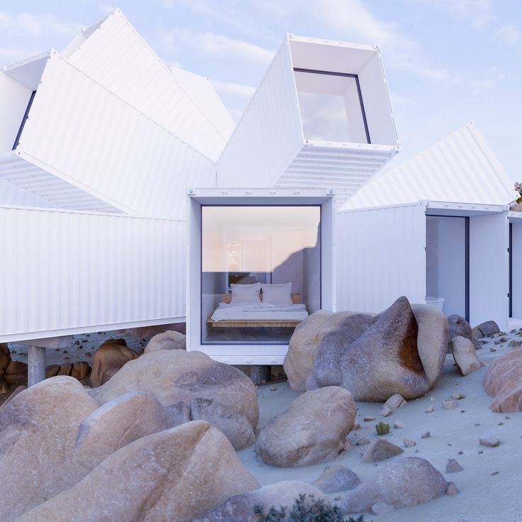 An office comprising a cluster of angled shipping containers, proposed for a site in Germany by James Whitaker but never realised, is now being built as a home in the California desert.
