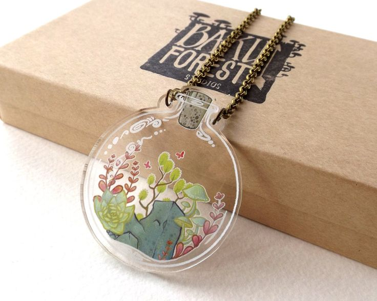 2D Bottled Terrarium Necklace on Clear Acrylic (17.50 GBP) by BakuForestStudios