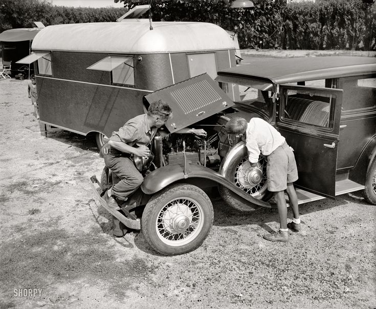 """Washington, D.C. June 4, 1937. """"Trailer camp.""""  The car is a 1931 De Vaux 6-75 sedan, according to one of the comments on the photo's page."""