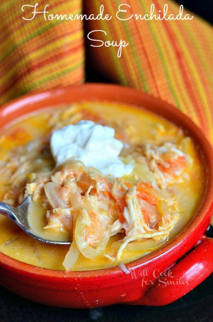 This is a homemade Creamy Chicken Enchilada Soup that captures the best enchilada flavors and topped with sour cream and cheese.