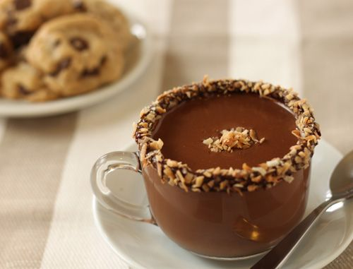 Almond Joy Hot Chocolate  yield: 2 small mugs of chocolate  1 cup almond milk, preferably homemade  1/4 cup coconut milk  3.5 oz (about 1/2 cup) milk or semi-sweet chocolate, or mix of chocolates. Don't use dark chocolate unless you like a slightly bitter cup of chocolate  toasted coconut  1-2 drops almond extract (optional)...