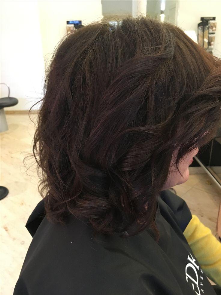 lang krullend bruin haar