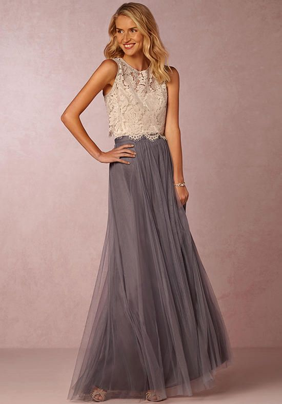 Featuring elegant lace, a slightly open back, and delicate fringe along them hem, we love this lace crop top paired with the Bare Camisole and Louise Tulle Skirt.