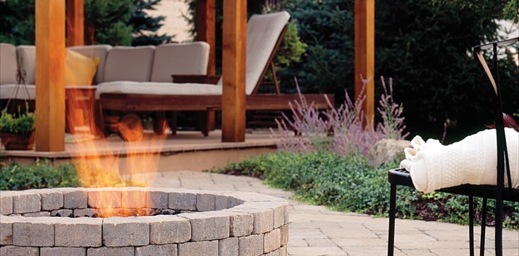 Round fire pit on lower level from pergola/living area