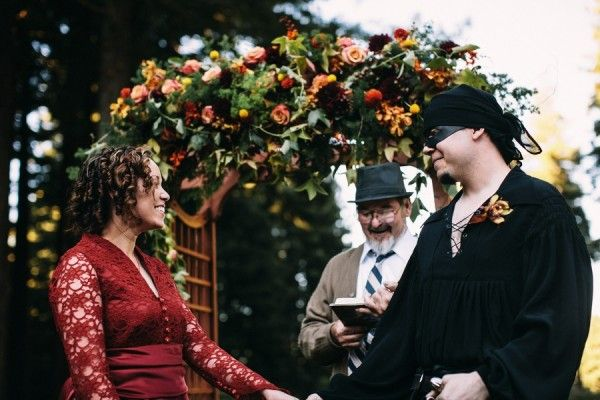 """""""A Princess Bride wedding channeling Westley and Buttercup themselves"""" - Even Peter Falk's role as the grandfather is represented by their officiant! (Click through for more pics at Offbeat Bride.)"""