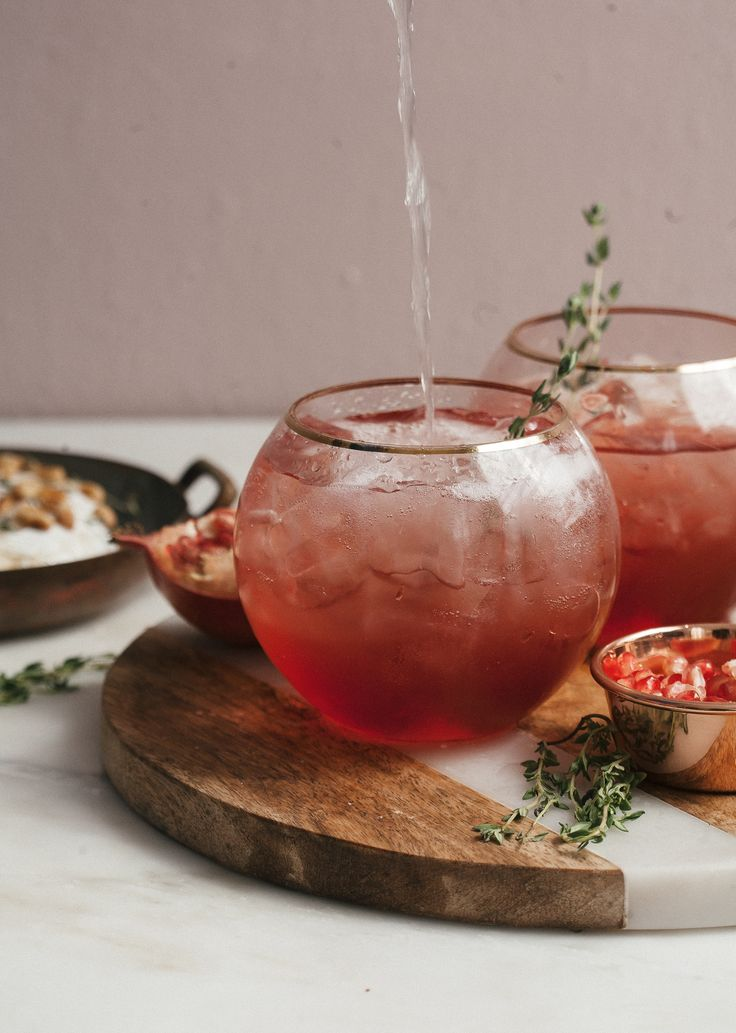 Blood Orange & Pomegranate Thyme Spritz cocktail - perfect for happy hour and serving guests when hosting brunch.