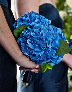 I'm thinking one head of blue hydrangeas each for the bridesmaids, plus a lot of greens - so more greens than hydrangeas (since their dresses are already blue).