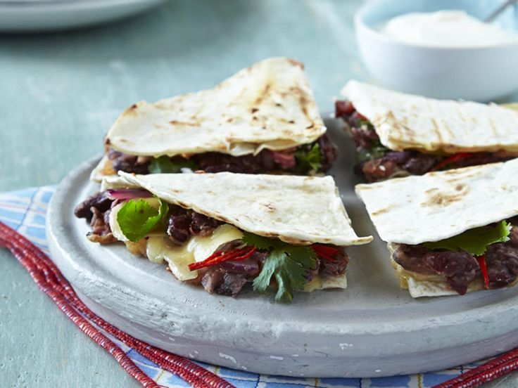 Easy kidney bean, tomato & pepper quesadillas Serves 4 Ready in 25 minutes 2 x 400g tinned kidney beans, drained and rinsed 15g fresh coriander, chopped, plus extra to serve Zest and juice of 2 limes, plus wedges to serve 3 tbsp Branston Tomato & Red Pepper Relish 1 red onion, thinly sliced 1 red chilli, deseeded, sliced (optional) 8 mini tortilla wraps ​200g cheddar cheese, sliced Ground black pepper