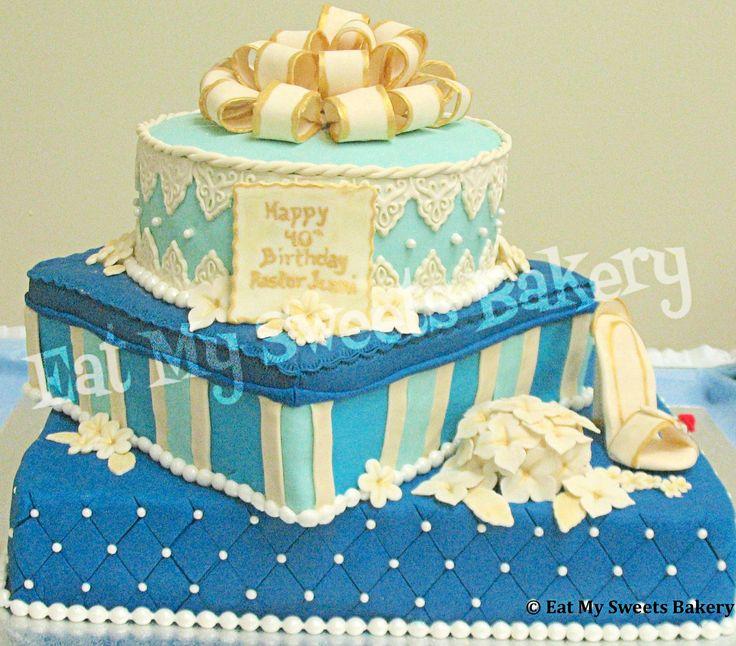 Birthday Presents Cake- Bottom vanilla, middle lemon, top chocolate. Has fondant decorations and edible pearls