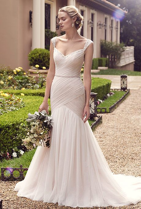 Casablanca Bridal. Freesia%u2019s breathtaking fit-and-flare silhouette has a bodice with light ruching that makes a flawlessly dramatic transition into the opaque tulle skirt. Exquisitely beaded tank top straps that extend from the sweetheart neckline, and a low back with a sweet detachable ribbon sash, complete the look.