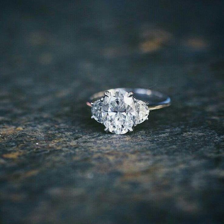Oval half moon three stone diamond engagement ring