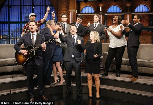 Lighters will do: The gang pulled out their lighters to emulate 'candles' as Chris sang one of the show's original ballads while Aubrey Plaza and Jim O'Heir 'made out' heavily
