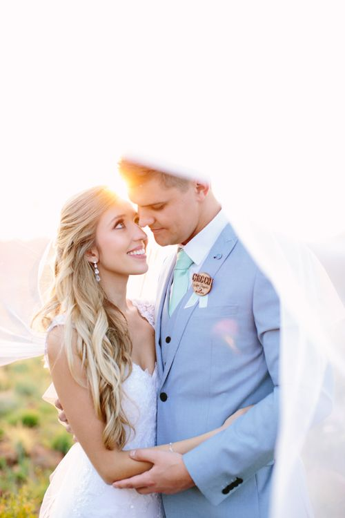 Monique's hair and makeup will take your breath away! Read more about these high school sweethearts' rustic wedding in South Africa on Love, Maggie!