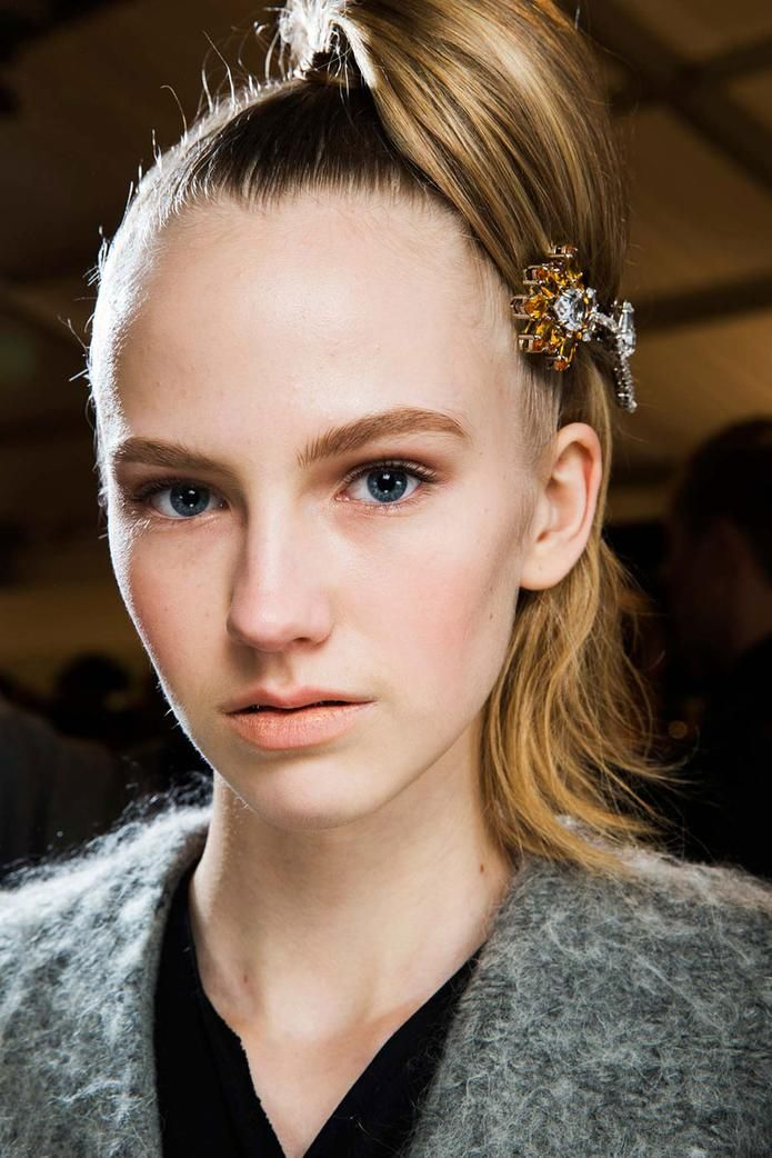 Prada Fall 2015: http://blog.mshopnyc.com/ladylike-gloves-and-the-new-ponytail-at-prada/