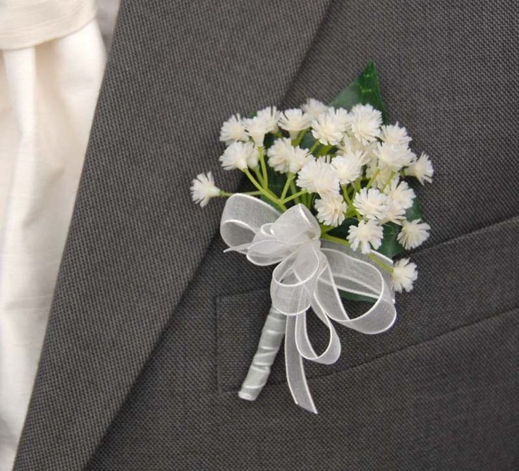 A Grooms handmade artificial buttonhole with  ivory  gypsophila also know as gyp and babies breath with an ivy leaf at the back.  The stem is ribboned in 9mm white orgnaza ribbon  with a handmade bow.    Measurements  Width:- 3 inches  Length:- 4  inches