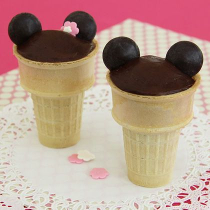 Yoo-hoo! Looking for a fun treat to serve at a family birthday party or barbecue? Here's one that fits the bill, courtesy of Mickey and his leading lady: whimsical chocolaty cone cakes your guests will find ear-resistible.