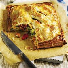 Roast vegetable and houmous pie recipe by Angela Boggiano. The sweet potato layer in this vegetarian pie base absorbs the steam released from the baking vegetables, thereby keeping the pastry crisp.