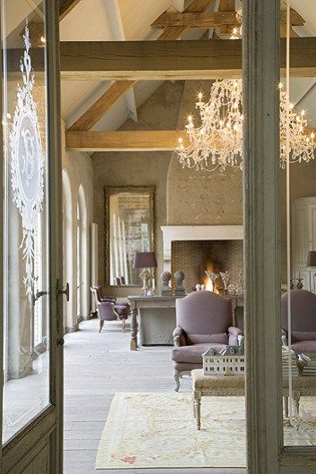 We love this barn conversion open plan living room with high beamed ceilings and statement fireplace and chandelier...x