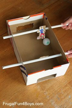 Upcycle a shoebox into a homemade foosball game! It's World Cup time, so it's a great time to make this soccer craft. In the interest of keeping things simple and creating a game that the younger boys could actually play (ages 5 and 7), we decided to make it one-on-one soccer. It would be …
