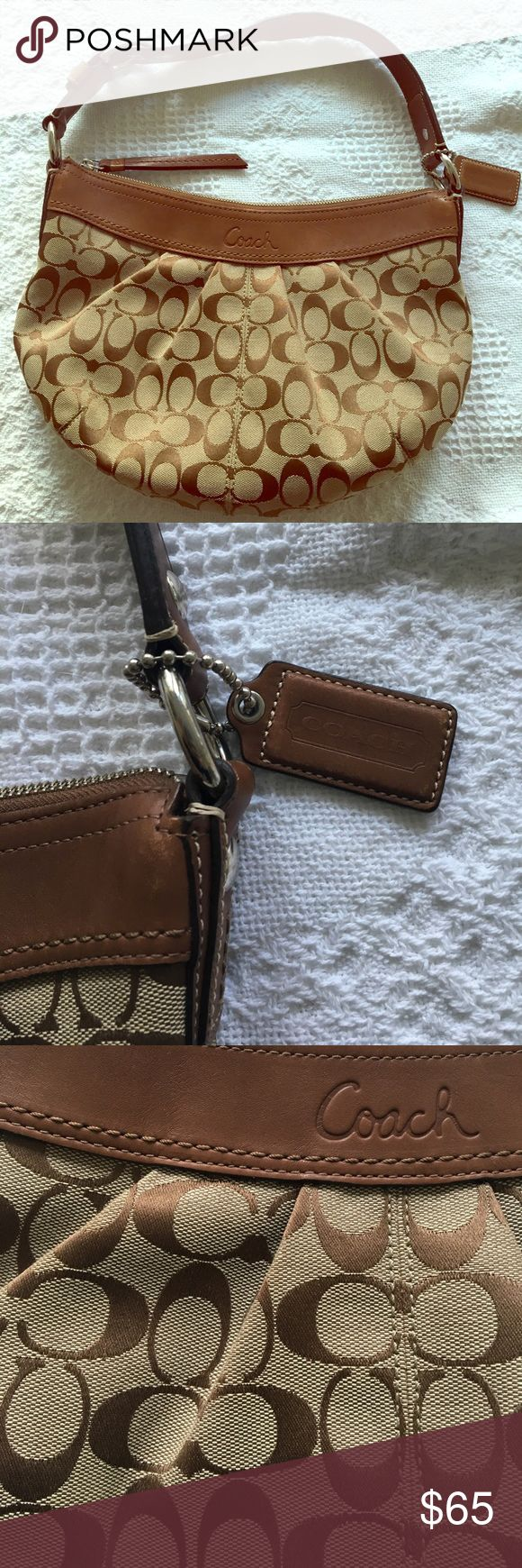 Coach bag- brown leather detailing/ classic print Great condition, very clean coach purse with the classic coach print. Adjustable strap detailing. This bag goes with everything! Coach Bags Shoulder Bags