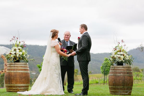 Wine Barrel decor for wedding ceremony styling. Photography by The Arched Window, Mount Tamborine.
