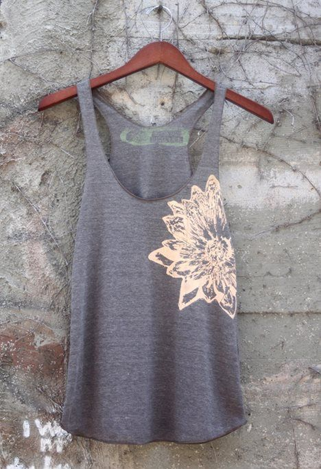 I love this tank because it is simple and then has a flower on the side which I think is so cute. I would love a tank like this. The colors are perfect in every way. Really liken this tank even more ~Me