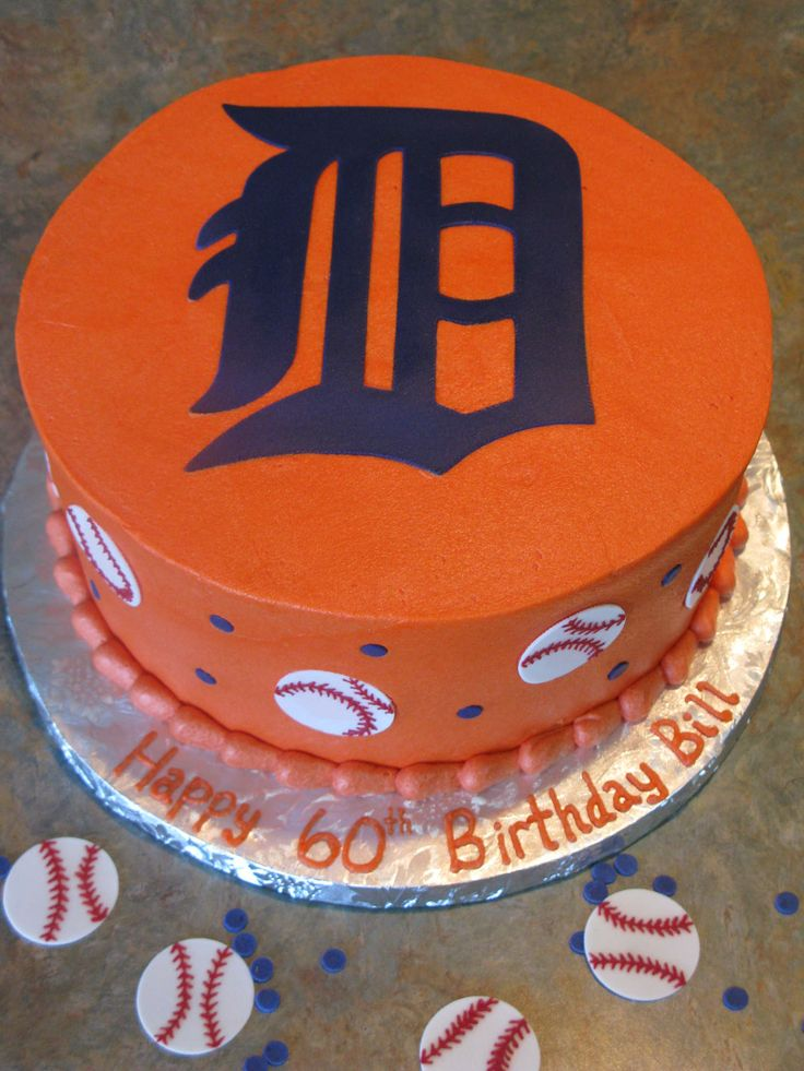 """Detroit Tigers - Three vanilla 9"""" layers covered in American buttercream.  I used my Silhouette Cameo to cut the Tigers logo, the baseballs and the blue dots out of gumpaste, then I piped the seams onto the baseballs.  The original design was an image I found on Google by Amy's Cakes.  TFL!!"""