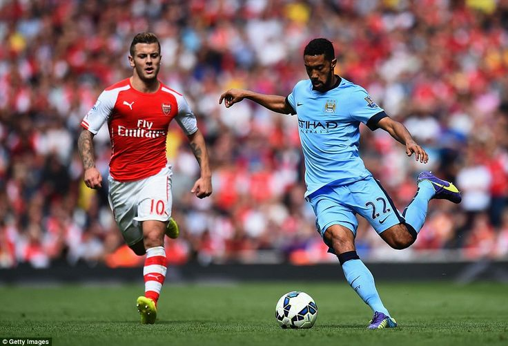 Jack Wilshere of Arsenal closes down former team-mate Gael Clichy, now of Manchester City,...