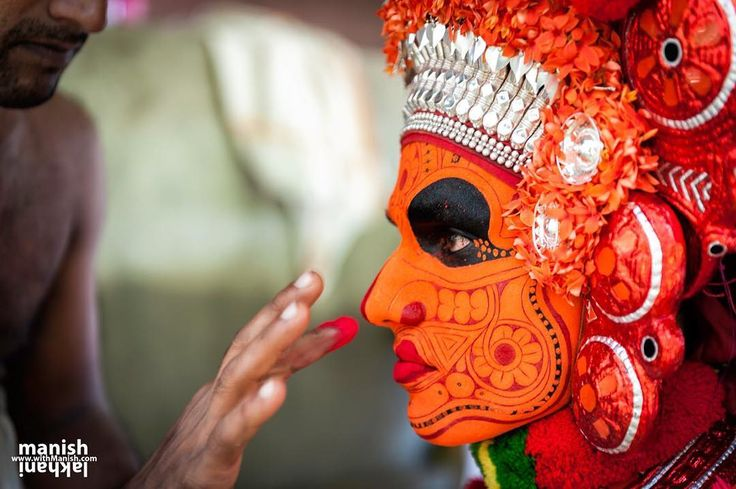 Theyyam artist makeup at final stage before he is ready for performance. If you are in India by Nov to March you can attend to a popular Hindu ritual of worship called Theyyam in southern state known as God's own country Kerala. Theyyam is performed by male members of particular castes only. Particular part of the castes who perform Theyyam dance and they are mainly from Malayan Munnutton Pulayan Velan Chungathan Koppalan Mayilon Vannan & Anjoottan and few more .... Theyyam is performed…