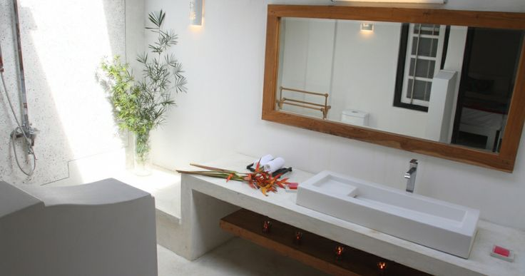 bathroom in Coco Tangalla. love the half wall shower partition