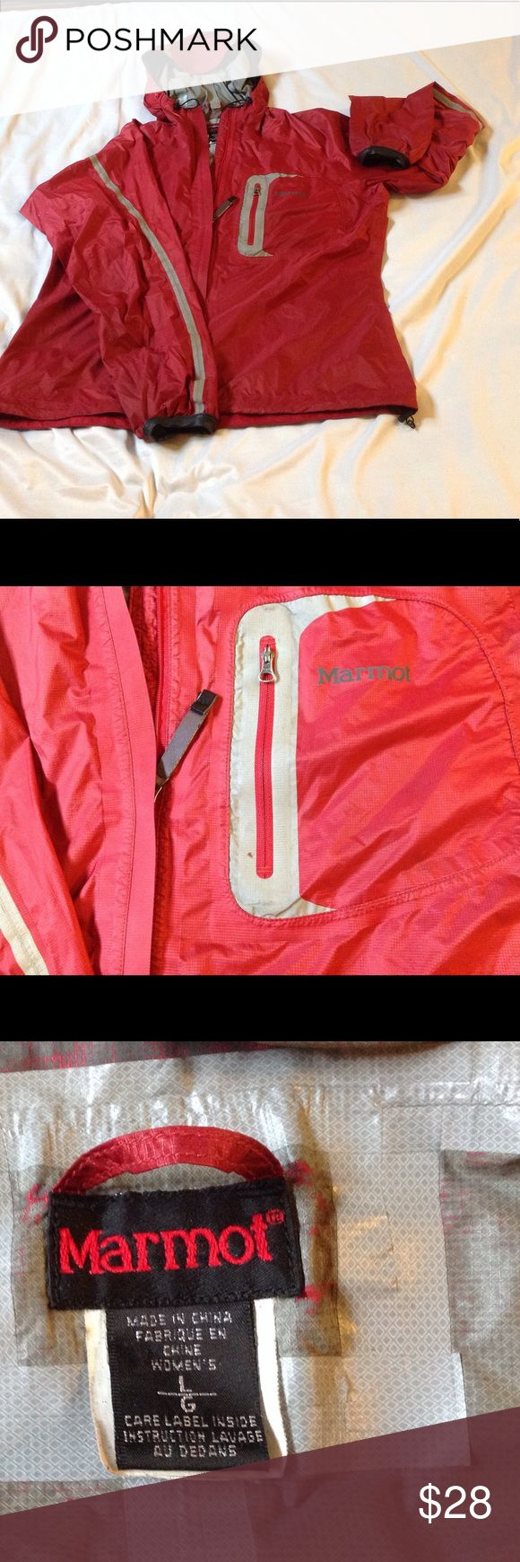 Marmot breathable shell with reflector fabric Good lightly used condition.  Reflector tape around front pocket has one small worn spot.  Back of lower left arm has bike grease stain that could be removed with a degreaser, both issues pictured. Marmot Jackets & Coats