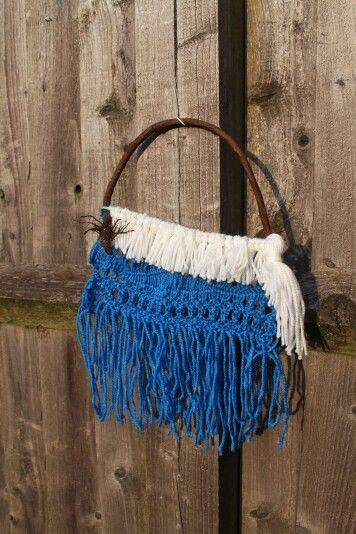 Ocean blue macrame on branch with roots