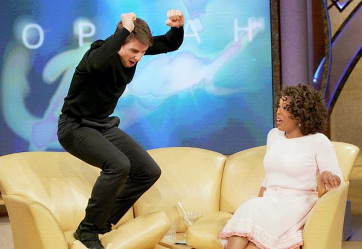 Oprah Winfrey's talk show and the now classic moment guest Tom Cruise jumped on her sofa!  Image credit - www.usmagazine.com