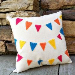 A simple way to add color to your home this spring: Make a pennant bunting toss pillow.