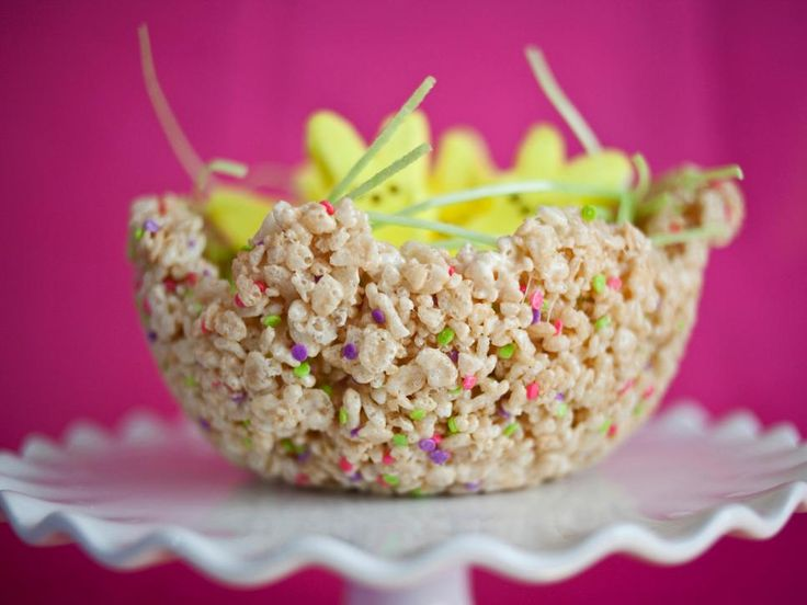 Make an edible Easter basket by stashing treats in a rice cereal bowl. Make rice cereal treats according to the package, adding colorful sprinkles if desired. Press the warm treats against the inside of bowls covered in wax paper. Let cool, and remove once hardened. Fill the bowls with edible grass and marshmallow bunnies and chicks.