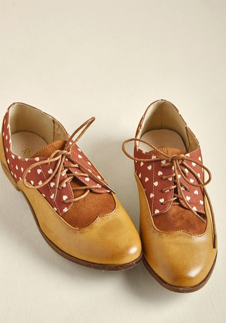 Loving Loyalty Oxford Flat | ModCloth If there's one pair of shoes to which you'll stay true, it's these patterned wingtips by Restricted Footwear! Mixing tawny faux leather, heart-printed auburn fabric, and brown faux-suede panels tucked in near the toes, this lace-up pair keeps your ensembles interesting and your soul satisfied with spiffy style.