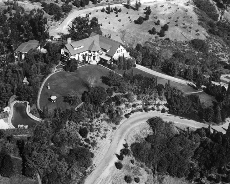 An aerial view of Pickfair, the home of Mary Pickford and Douglas Fairbanks, located at 1143 Summit Drive in Beverly Hills, taken from the far side of the swimming pool area.