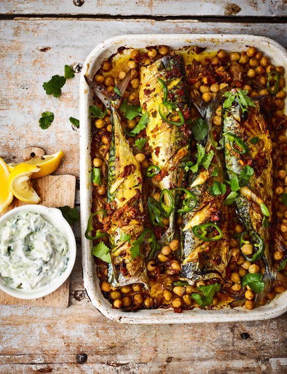 Turmeric roast mackerel recipe with spiced chickpeas and raita - not your average roast recipe! This flavour-packed mackerel dish makes a wonderful spring supper.