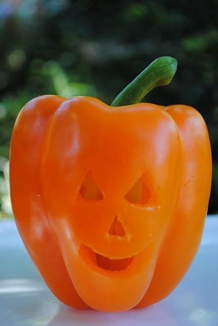 How fun! A pepper can sub for a pumpkin for a little Jack o' lantern