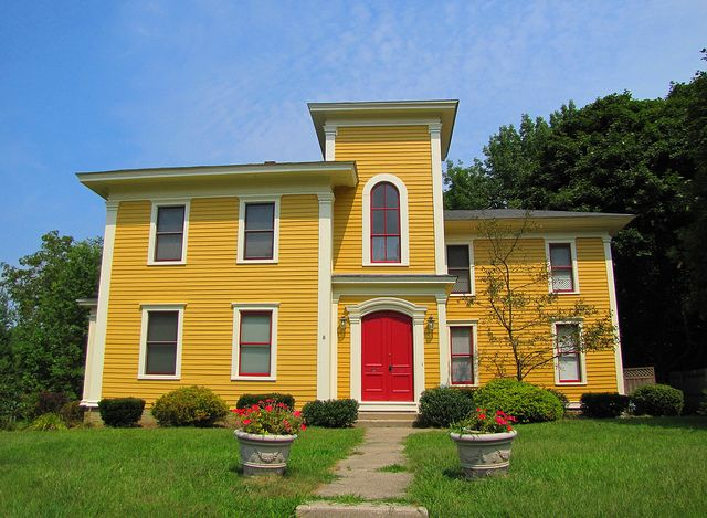 Houses with red doors yellow house red door flickr photo sharing and two guards for Exterior paint yellow