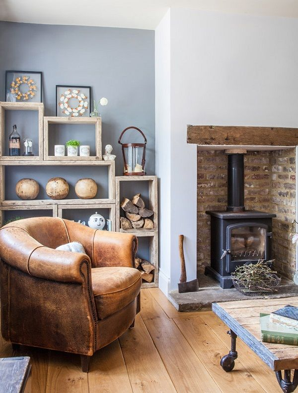 fireplace ideas - woodburner and rustic wooden shelves in the alcove