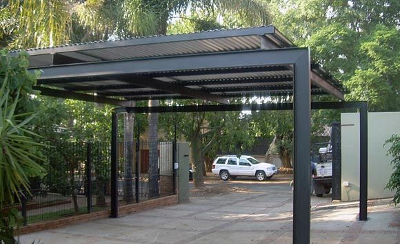 "metal carport - unashamedly modern /""industrial"" styling."