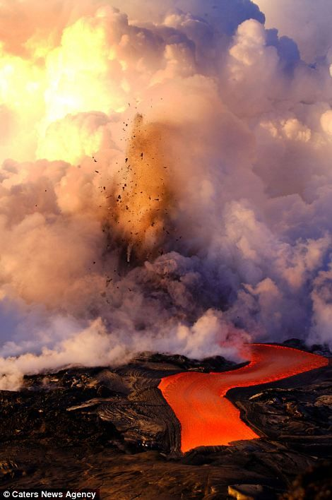 Daredevil photographers brave boiling waters to capture the drama of searing-hot lava crashing into the seas off Hawaii